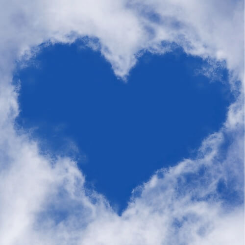 Blue sky with a heart made from clouds